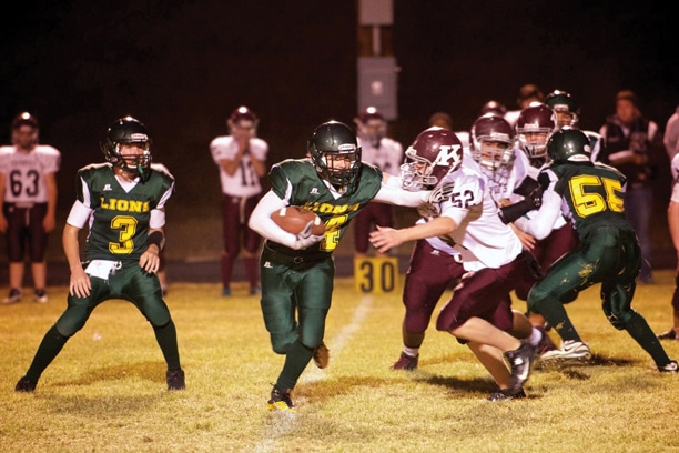 Liberty Bell running back Jacob McMillan gains ground while quarterback Chip Jones (No. 3) follows the play and Cesar Dominguez (No. 55) blocks the Kittitas line. See page B2 for another photograph from the game. Photo by E.A. Weymuller
