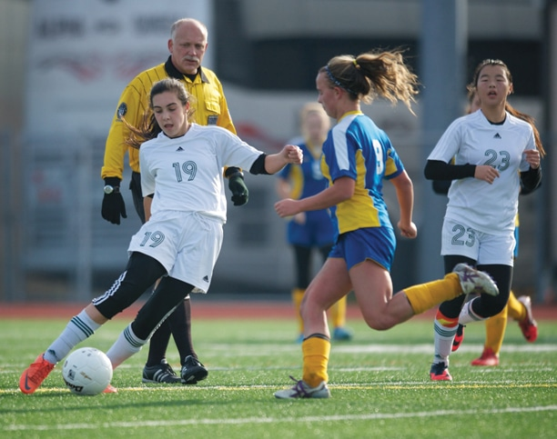 Danielle Mott (No. 19) advanced the ball while teammate Mia Kennedy (no. 23) stayed close in the Lady Lions' victory over Adna in an overtime thriller that earned Liberty Bell the third-place trophy at last weekend's state soccer championships. Photo by E.A. Weymuller