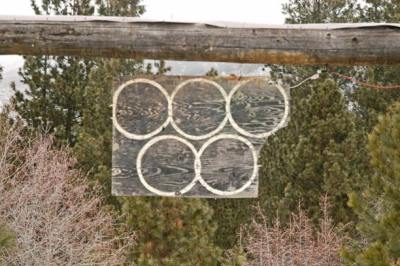 The Olympic rings that hang over the entry leading to Jim and Jan Gregg's property north of Winthrop.