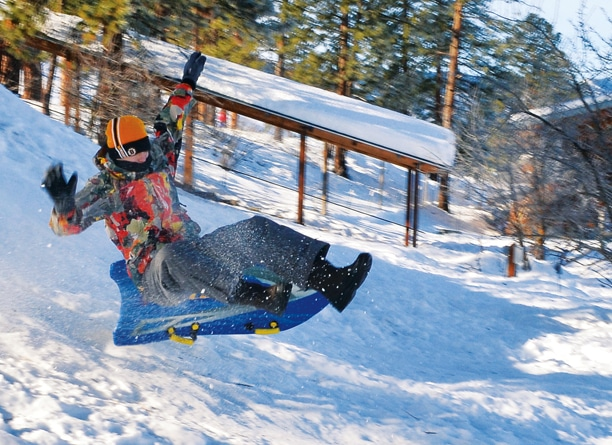 A sledder caught some air on a perfect winter day near the Town Trailhead in Winthrop. Photo by Laurelle Walsh