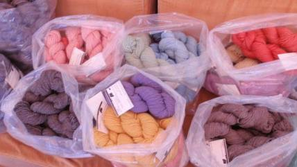 Katie Haven produces colorful wool skeins at her ranch. Photo by Joanna Bastian