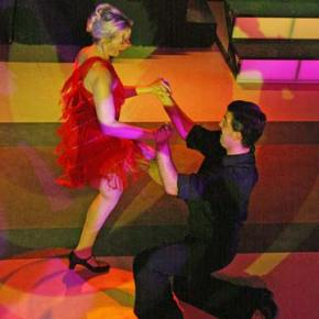 """Local woman, Jenn Tate, performs a salsa number to the tune of """"Ran Kan Kan"""" with Jesse Maher of the Utah Ballroom Dance Company at the Dancing with (Your) Stars event sponsored by Methow Arts on Saturday, March 8. Photo by Marcy Stamper"""