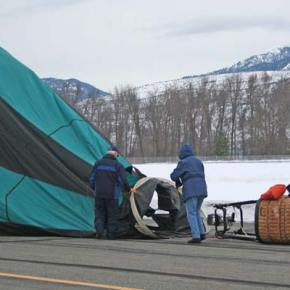Pilot Dale Justice, left, and first crew chief Mary Heath work to get the Outer Limits balloon ready to pack up for transport. Photo by Darla HusseyPhoto by Darla Hussey