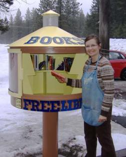 Lisa Picklesimer takes a break from her job at the Mazama Store to grab a book. Photo by Bob Spiwak