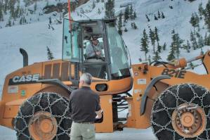 Don Becker, foreground, consults with one of the WSDOT crew members who are clearing the North Cascades Highway. Photo by Ann McCreary