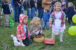Adelina Humling, left, Nova Gehring and Wylie Smith prepare to fill their baskets with goodies. Photo by Laurelle Walsh