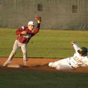 Sophomore outfielder Gavin Wengerd is safe at second despite an attempt by the Kittitas catcher to throw him out. Wengerd later scored off a single by Chip Jones.Photo by Mike Maltais
