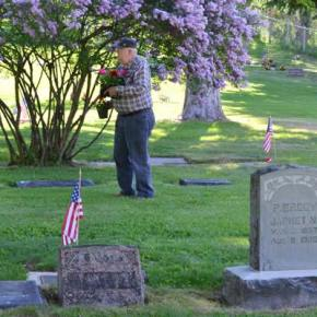 Bob Hough, born and raised in the Methow Valley, finds the graves of his Hough, Rader and Baskin family members. Photo by Laurelle Walsh