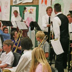 Dr. Mark Johnson presented senior Liam Daily with gift of appreciation for being a member of the band since fifth grade. Photo by Darla Hussey