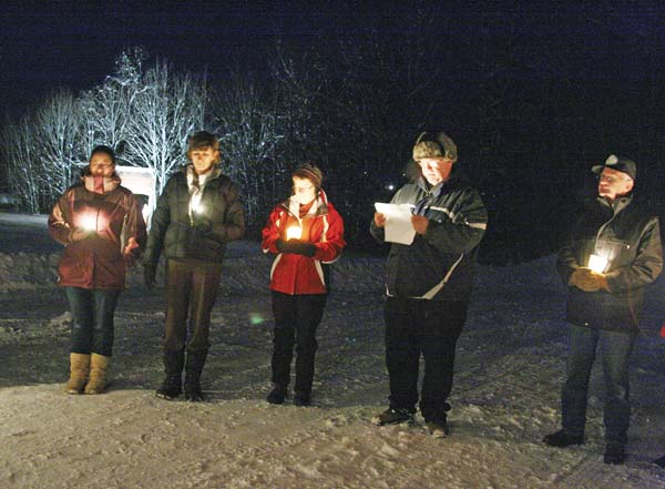 Mike Lawson, second from right, shared reflections at a community candlelight vigil for the victims of the Newtown, Conn., shootings in December 2012. File photo by Marcy Stamper