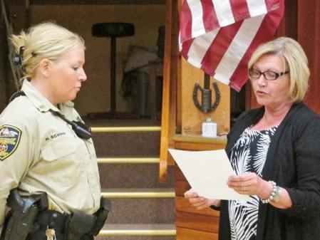 Mayor Sue Langdalen, right, swears in Rikki Schwab as the new town marshal. Photo by Don Nelson