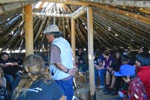Methow tribal elder Spencer Martin, descendent of Chief Moses, addresses students, faculty and guests of the Paschal Sherman Indian School who celebrated the completion of the traditional pit house at the Methow Valley Interpretive Center last Wednesday. Photo by Laurelle Walsh