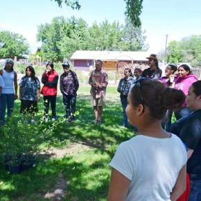 Students, faculty and guests of the Paschal Sherman Indian School gather after the pit house dedication. Photo by Laurelle Walsh