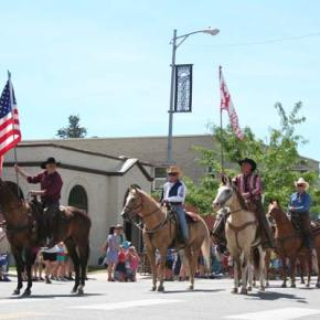 Members of the Methow Valley Horsemen, led by Ray Campbell and Dennis Gardner, ride tall down Glover Street. Photo by Darla Hussey
