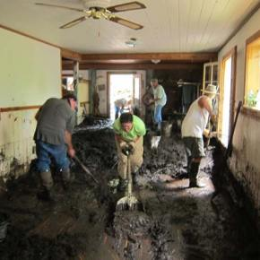 Shoveling mud from the Elk/Lewis home. Photo by Don Nelson
