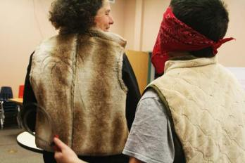 "Photo by Marcy Stamper Sixth-grader Timothy Darwood ""groomed"" a simulated horsehair vest worn by horse club leader Annie Budiselich, program director at Methow Valley Riding Unlimited."