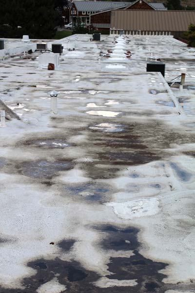 Photo by Don Nelson Three Rivers Hospital's often-patched roof is one of the critical repair projects at the hospital.