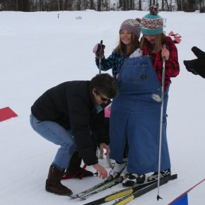 """Photo by Darla HusseyJess Dinham, in turquoise plaid, and Payton Kaufmann — along with doggy Sucia — won the coveted """"golden poodle"""" award for their costume, """"Two-headed country skiier."""""""