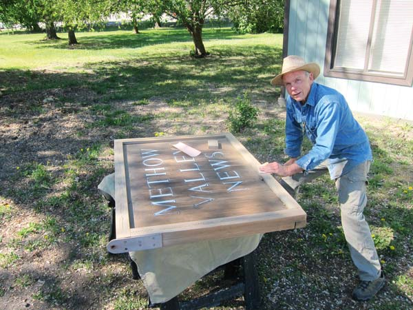 Photo by Don Nelson Bruce Morrison worked on restoring the Methow Valley News sign.