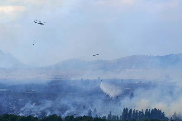 File photo by Laurelle Walsh The Rising Eagle Road Fire, which started on Aug. 1, 2014, burned 579 acres and destroyed 10 houses.