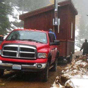 Snowmobile club installs warming hut at Sweetgrass