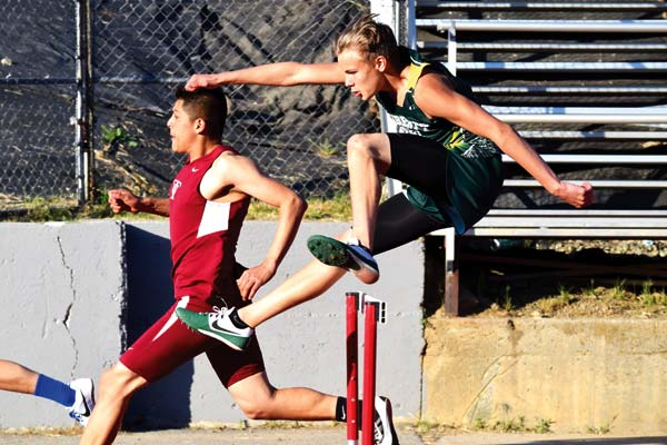 Photo by Erik Brooks Freshman Brayden White set a personal record in the 300-meter hurdles at the Reike Invitational in Peshastin.