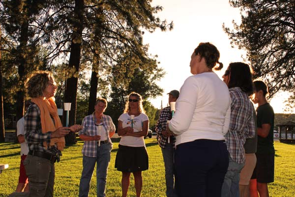 Photos by Don Nelson About 20 people gathered at Mack Lloyd Park on Sunday night for a candlelight vigil commemorating victims of the Orlando shootings.