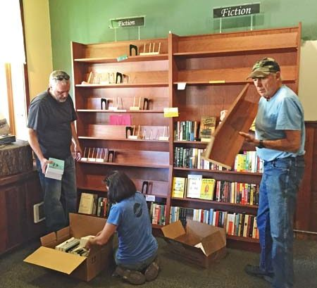 Photo by Ashley Lodato Volunteers help pack up and move the Trail's End Bookstore inventory this week.