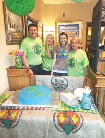 Photo courtesy of Beau Adams Farmers State Bank staffers Beau Adams, left, Roxanna Adams, Taylor Ferrill and Cathy Coin celebrated Earth Day with an appropriately decorated cake.