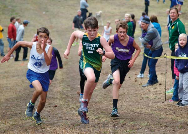 Photo by Erik Brooks Liberty Bell's Zane Strome tackled the final hill in the boys' junior varsity race at Leavenworth.
