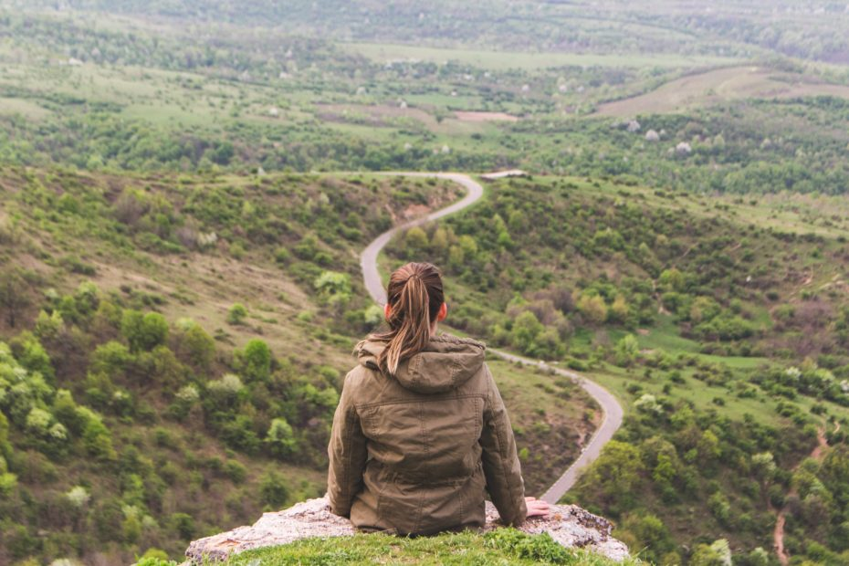 girl thinking while looking at a road