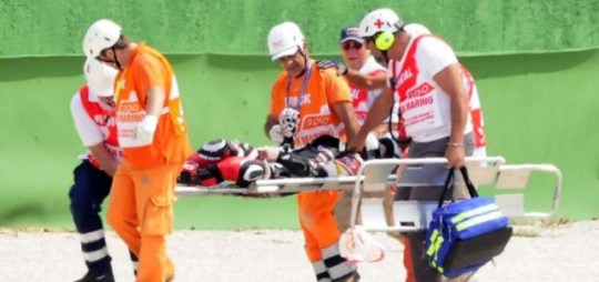 Shoya Tomizawa is stretchered from the track following a horrific crash at the San Marino Grand Prix (Picture: Reuters)