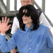 Jacko makes lone trip to UK
