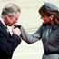 Charles kisses Carla as Sarkozy arrives in Britain