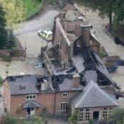 Third body found at fire mansion