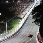Massa takes pole under lights