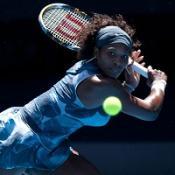 Serena overcomes heat to go through