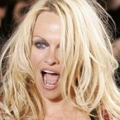 Pamela Anderson wears a  Vivienne Westwood creation on the catwalk in Paris