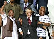 Al-Megrahi is greeted on his return to Libya