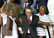 Al-Megrahi is greeted on his return to Libya