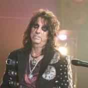 Alice Cooper's snake appeared in a country singer's toilet