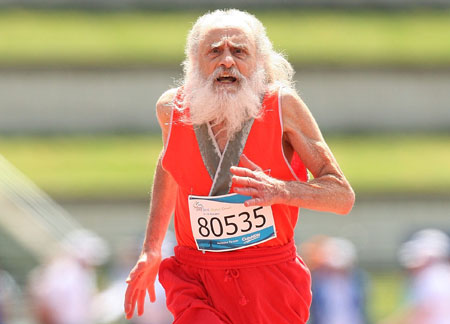 O Santa Claus competes in the men's 100m