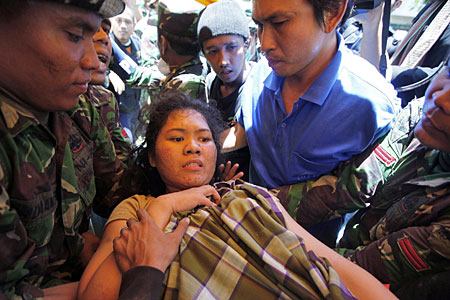 Sari is pulled to safety in a dramatic rescue