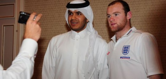 England's Wayne Rooney poses for a photo following an England Press Conference