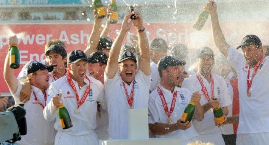 Back on our sscreens? England captain Andrew Strauss (C) holds the Ashes trophy aloft as England defeats Australia