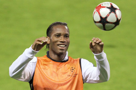 Back on the ball: Drogba trains in Madrid last night