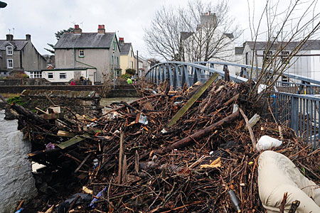 Debris piled up against a closed footbridge in Cockermouth after flood water receded