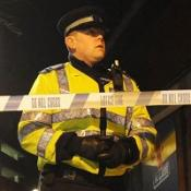 A man is being quizzed following the discovery of two bodies in a house