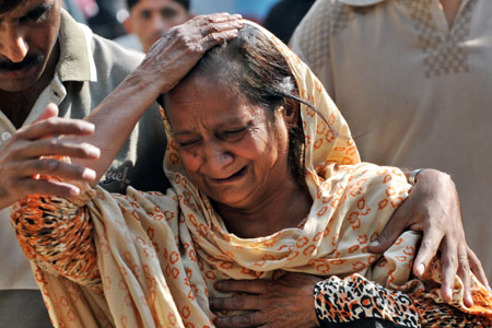 A woman mourns the death of a relative in the recent explosion at Rawalpindi