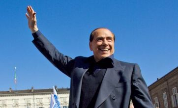 Scarred Silvio Berlusconi gets back to work – looking out for numero uno
